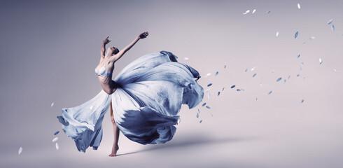 Woman dancing in flowing blue dress