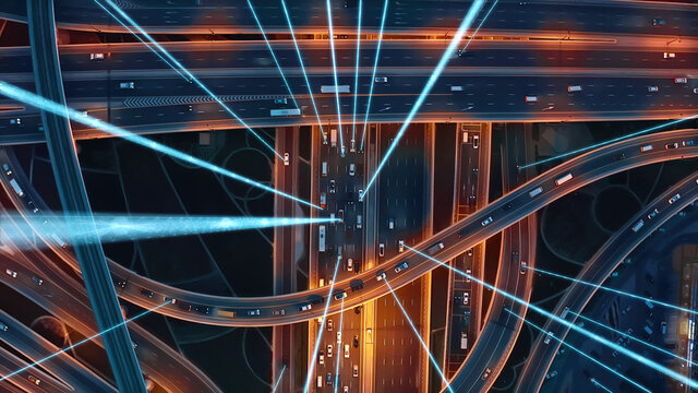 Internet Of Vehicles Autonomous Driving Systems Connected Cars Communicating Via Artificial Intelligence With Satellite Beams Information Signals Digital Highway Connection 5G Smart City Traffic Road