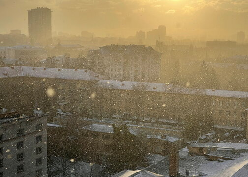 A view shows a residential area during snowfall in Kyiv