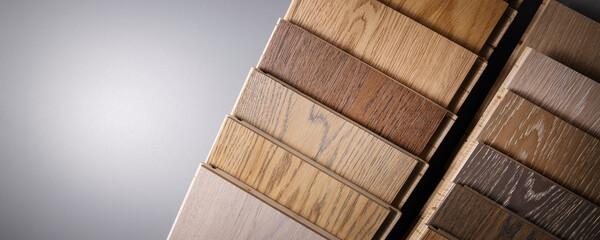 Obraz oak parquet flooring samples on gray background with copy space - fototapety do salonu