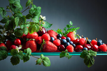 Various juicy berries with leaves.