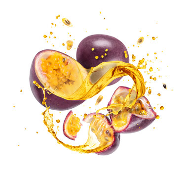 Whole and sliced passion fruit with splashes of juice, isolated on a white background