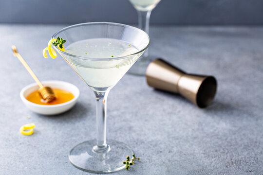 Honey and thyme lemon drop martini with a lemon twist