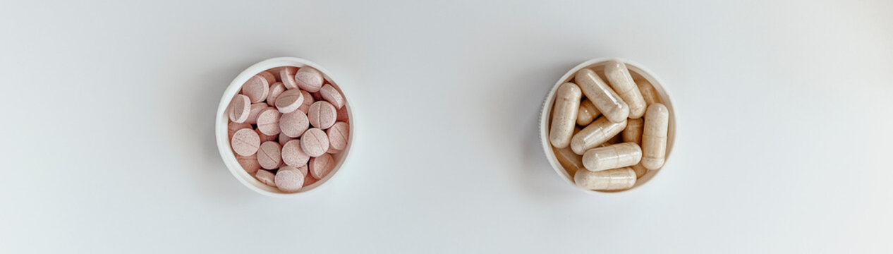 banner: close-up of vitamin B-12 (methylcobalamin+dibencozide) chewable tablets and vitamin B6 (pyridoxal-5-phosphate) capsules. dietary concept. dietary supplement topview photo
