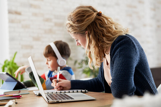 Mother during home office and son during homeschooling