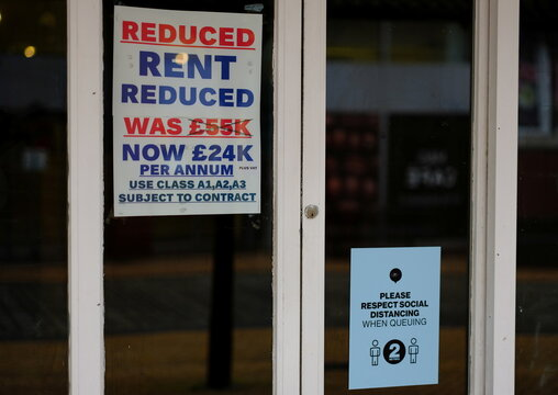 A sign offering reduced rent fees is seen in the window of a closed retail unit in Blackpool