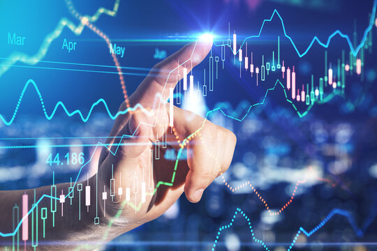 Forex trade market analysis concept with man finger pointing to financial diagram on digital board with stock market indicators
