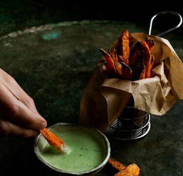 Sweet potato french fries with green sauce