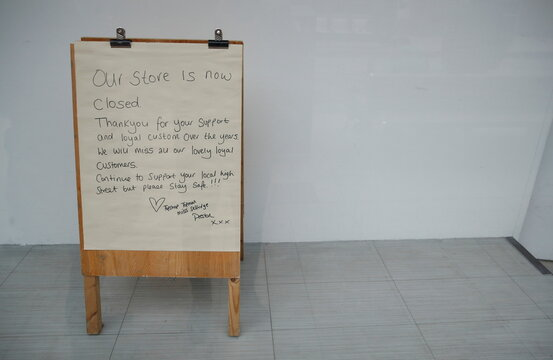 A sign thanking customers for their support is seen in the window of a closed former Top Shop store in Preston