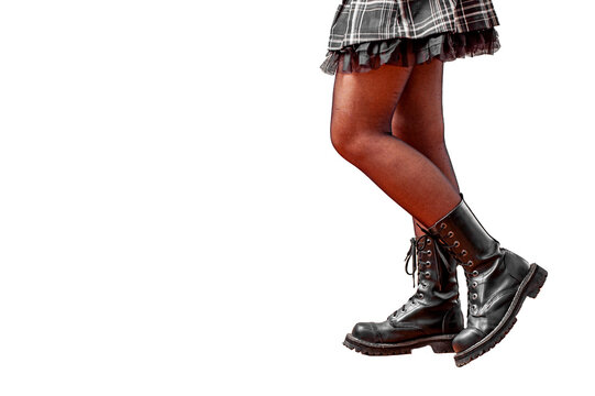 Young woman legs in black leather boot isolated on white background