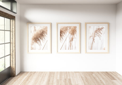 three Frames in a Room with Large Windows