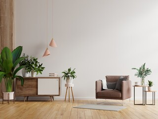 Modern minimalist interior with an armchair on empty white wall background.