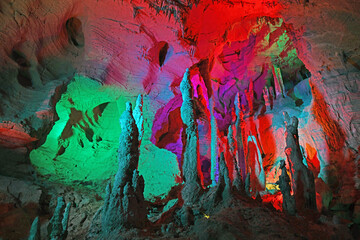 Karst cave with colorful light