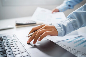 Obraz Business woman working in finance and accounting Analyze financial budget in the office - fototapety do salonu