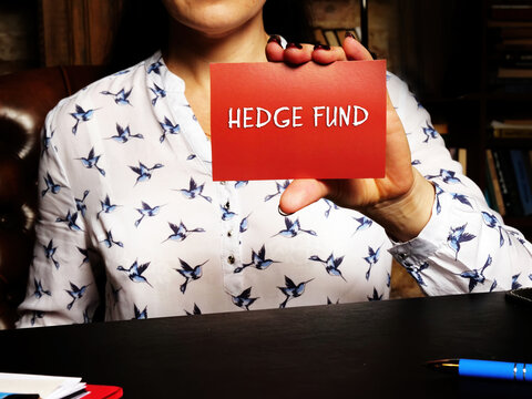 Business concept about HEDGE FUND with inscription on the page. A pooled investment fund that trades in relatively liquid assets and is able to make extensive use of more complex trading