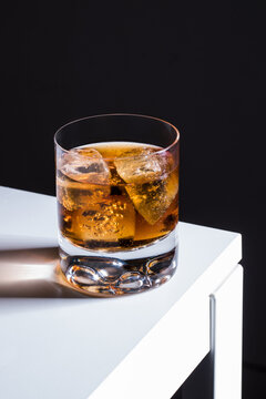 Alcohol Old fashioned cocktail with whiskey and bitters garnished ice cube served in glass