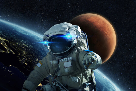 Space man in a space suit flies in open space on a background of the blue planet earth and the red planet Mars. Astronaut start a mission in outer space and travel to Mars. journey in cosmos