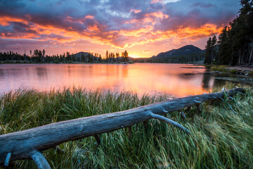 dramatic and vibrant summer sunrise in Sprague Lake in Rocky Mt National Park