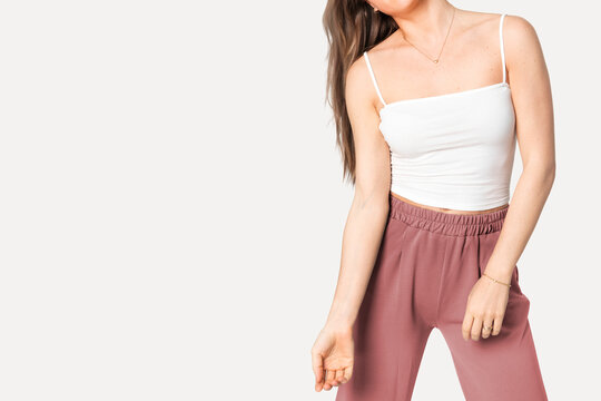 Woman in white tank top and pink lounge pants