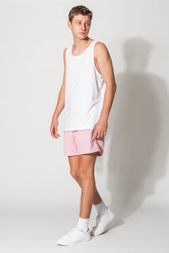 Men's white tank top and pink shorts for youth summer apparel shoot with design space