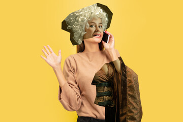 Woman talking phone. Magazine style collage with model outfit mixed of different eras. Copyspace for ad. Trendy colors, modern and vintage, renaissansse fashion. Cintemporary art collage.