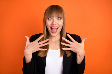 Photo of impressed nice blond hair lady hands wear black jacket isolated on bright orange color...