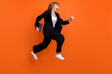 Full size profile side photo of happy excited crazy smiling woman running with laptop in hands...