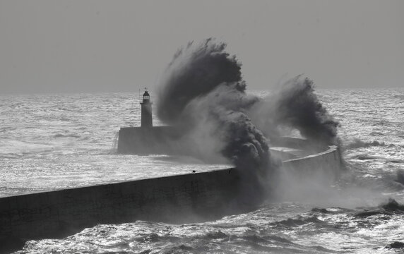 Large waves hit the harbour wall at Newhaven