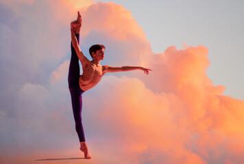 teenage ballet dancer dances barefoot under colored light.