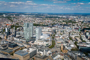 Panorama with modern skyscrapers, aerial view from a height of 200 meters, observation point at the main tower, city center at sunny summer day, cityscape, Frankfurt am Main, Germany Wall mural