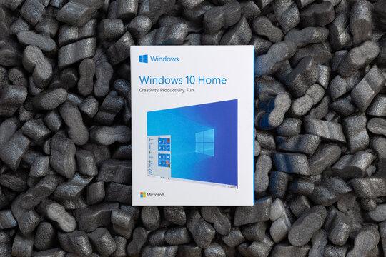 Prague, CZ-14 January 2021: Microsoft Windows 10 Home USB Flash Drive retail  installation box for desktop fall in Packaging foam Peanuts. Illustrative Editorial