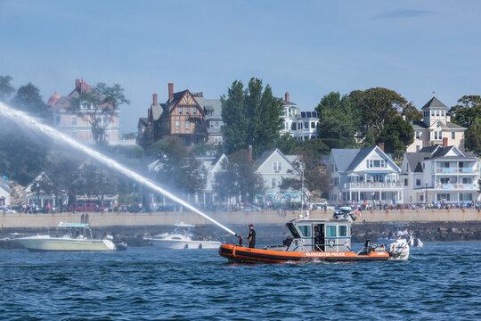 USA, Massachusetts, Cape Ann, Gloucester. Gloucester Schooner Festival, fireboat welcome salute with water cannon.