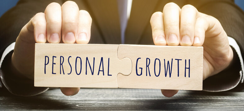 Wooden puzzles with the word Personal growth in the hands of a businessman. Self-improvement of skills, knowledge, personal qualities and life goals. Motivation and self-motivation concept