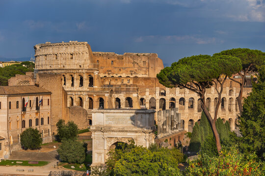 Italy, Rome, View of Colosseum and Arch of Titus