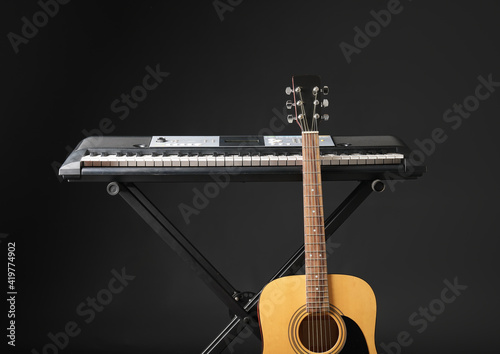 Acoustic Guitar And Synthesizer On Dark Background Wall Mural Wallpaper Murals Pixel Shot