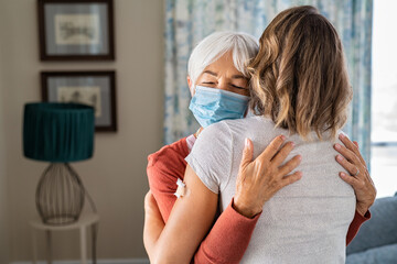 Fototapeta Grandmother hugging daughter after covid19 vaccination obraz
