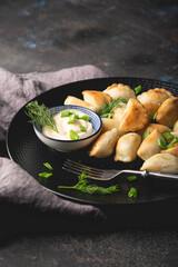 Dumplings, pelmeni, ravioli, pierogi on the table