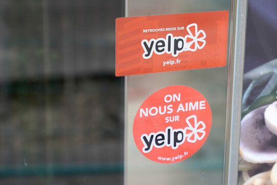 Yelp emblem sign text and brand Logo on Business windows shop