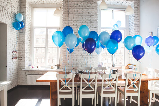 Room decorated with blue balloons
