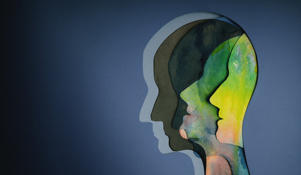 Mental Health Concept. Bipolar Disorder Person. Layers of Paper Cut as Human Head presenting Different of Emotions