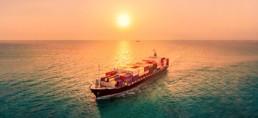 Fototapeta Smart cargo container  ship at sunset import export container concept freight shipping sea port.