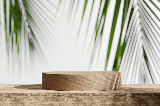Wooden product display podium with blurred tropical palm leaves background. 3D rendering