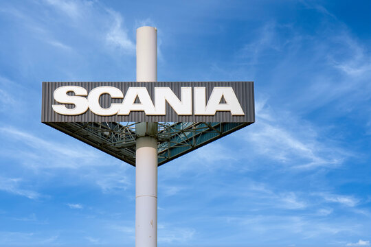 Billboard Scania truck factory against blue sky with whispy clouds