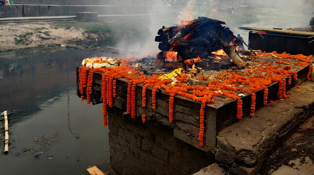 Burning Hindu funeral pyre,Hindu funeral rights of burning the body on a tall wooden funeral pyre in Nepal