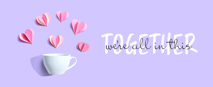We are All in This Together message with a coffee cup and paper hearts