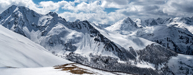 Snowcapped Caucasus mountain ridge. Winter landscape in Arkhyz (Karachay-Cherkessia, Russia)