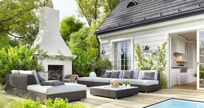 Cozy patio area with garden furniture, swimming pool and outdoor fireplace