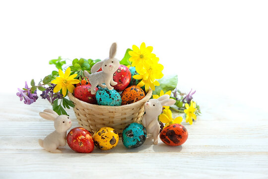 Easter holiday. cute Easter bunny and eggs with flowers on white background. festive spring season. Ostara sabbath, wicca pagan tradition. spring equinox