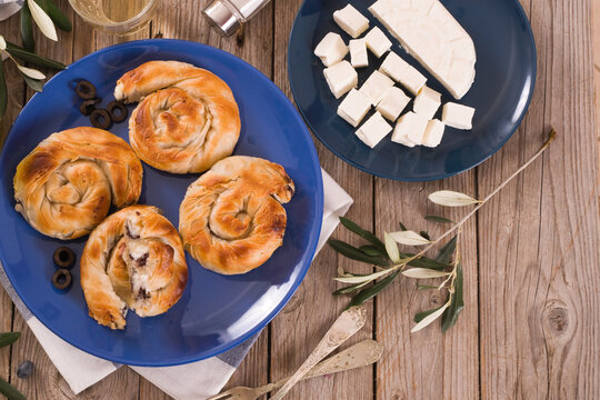 Pastry swirls with cheese and olive filling.