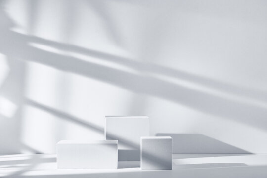 Background for product presentation with shadows and light. Empty podiums. Mockup.